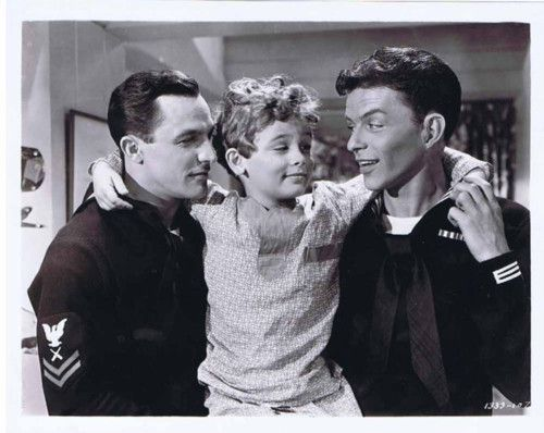 "Gene Kelly, a very young Dean Stockwell, and Frank Sinatra, ""Anchors Aweigh"" (1945)."