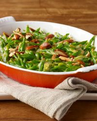 Green Bean Casserole with Goat Cheese, Almonds and Smoked Paprika | Inspired by classic green bean casseroles from his childhood, F&W's Justin Chapple put a Spanish spin on this timeless favorite by topping the creamy beans with smoky pimentón de la Vera and toasted almonds.