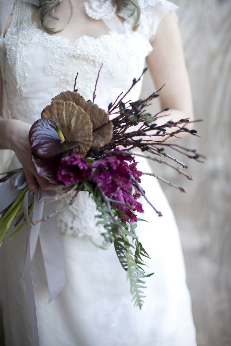 ok. this bouquet totally rocks. -- Hand tied cascade bouquet with dried mushroom and twigs, fern, parrot tulips and anthirium.