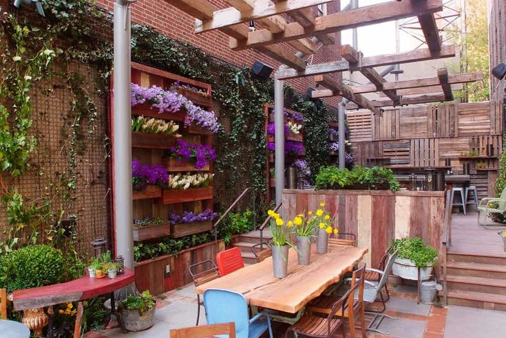 This rustic patio features beautiful vertical garden walls with all kinds of different foliage. The whole look of this patio has been completely revamped with the life the plants have brought to this space. You could use all types of plants with space this large, but you can also scale it down if you needed to. This is a gorgeous way to have a vertical garden suitable for entertaining purposes as well.