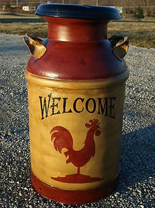 Antique primitive country farm dairy milk can...I could use this by the kitchen and garage door to place umbrellas and canes...