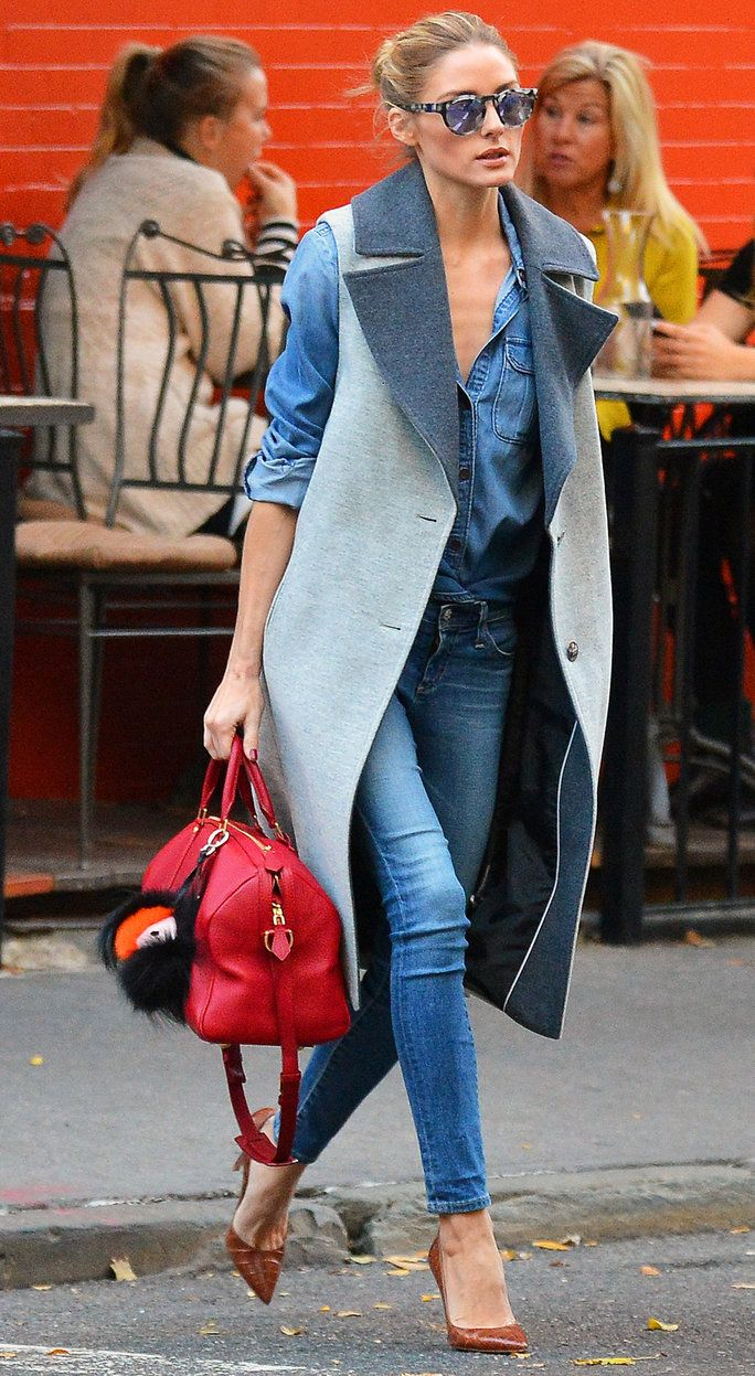 Olivia Palermo wore her go-to off-duty ensemble, denim on denim, but she took it up a notch by topping it with a wool two-tone sleeveless coat and caramel brown croc pumps.