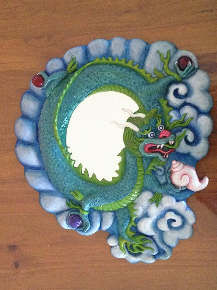 3d dragon mirror, sculpted and cast in hardened plaster then painted in acrylics