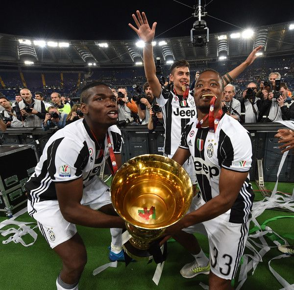 Paul Pogba, Paulo Dybala and Patrice Evra of Juventus FC celebrate the victory after the TIM Cup match between AC Milan and Juventus FC at Stadio Olimpico on May 21, 2016 in Rome, Italy.