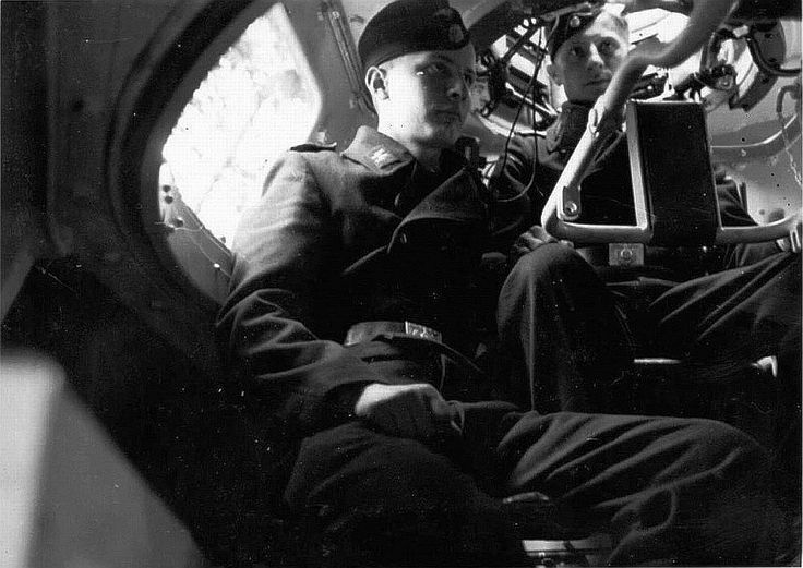 Inside a German PZ IV tank. Seen is the tank commander (standing on background) and the main gun man (sitting left).