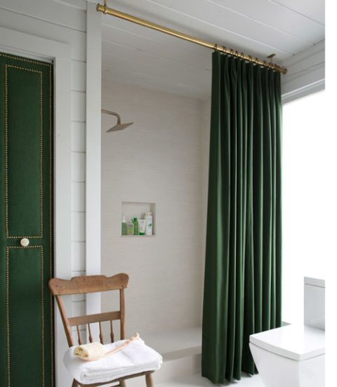 Removing the tiny tub made way for an extra-large shower space. The ceiling-mounted curtain (a custom cotton panel with a waterproof liner) creates the illusion of higher ceilings.