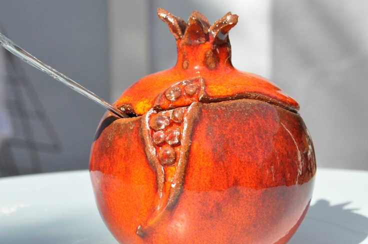 Orange-red ceramic pomegranate with opening lid for food sevings. $39.00, via Etsy.