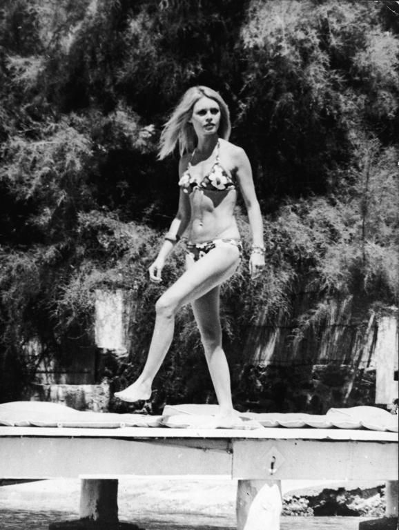 8 Style Tricks to Steal From 70s Fashion Icon Brigitte Bardot - Bardot in a floral triangle bikini top + matching bottoms  | StyleCaster.com