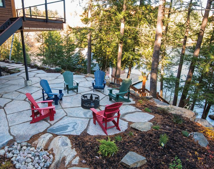 Muskoka Rock produces level flagstone that provides safe and even surfaces for outdoor furniture, as seen in this circle of Muskoka chairs surrounding a firepit.