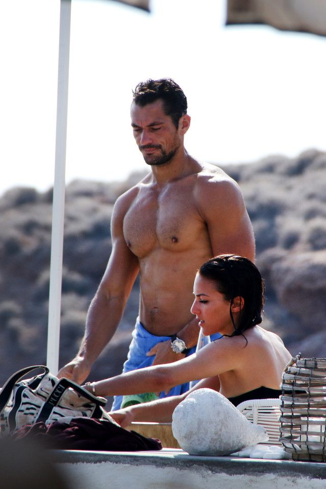 EYE GANDY Hunky David Gandy shows off his washboard abs as he indulges in a spot of sunbathing The 36-year-old was on holiday IN Greece with new girlfriend Stephanie Mendoros