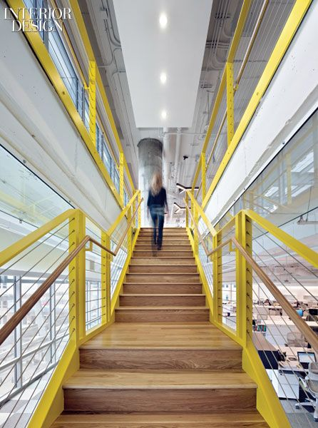 TM Advertising office: White-oak steps rise between painted steel balustrades strung with stainless-steel cable.