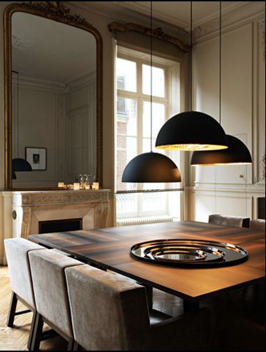 Paris Apartment by Studio Ko, with modular pendants, square wood dining table, and fireplace