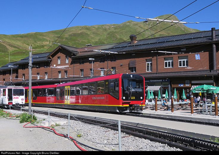 223 & 212 Jungfraubahn Bhe 4/8 at Bern, Switzerland by Bruno Dietliker