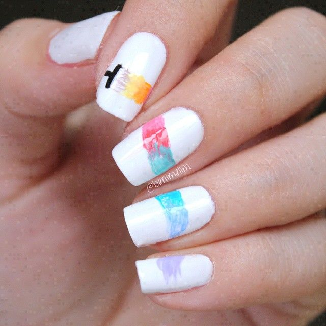 Colorful paintbrush painting nails by @benimelim!