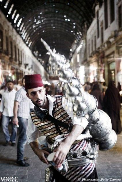 A vendor selling rose and tamarind tea in the Souk Al Hamidyeh.    © Photographer Pablo Zamora.