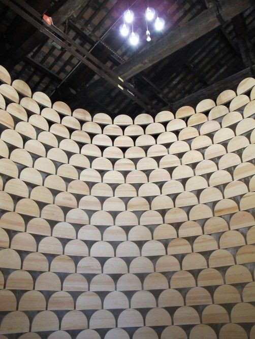 A wall made of low wooden stools from Kosovo (Image: Phyllis Richardson)