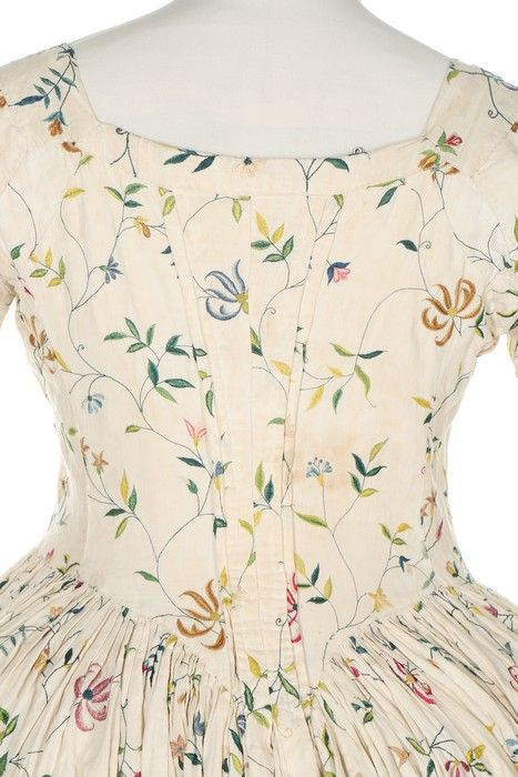 Detail rear view, open robe, England, 1770s. Cream linen, embroidered in silks with meandering stylised honey-suckle trails.