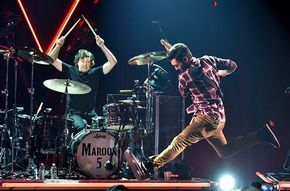 Matt Flynn and Adam Levine of Maroon 5 perform during the iHeartRadio Album Release Party with Maroon 5 LIVE on the CW at iHeartRadio Theater in Burbank, California.