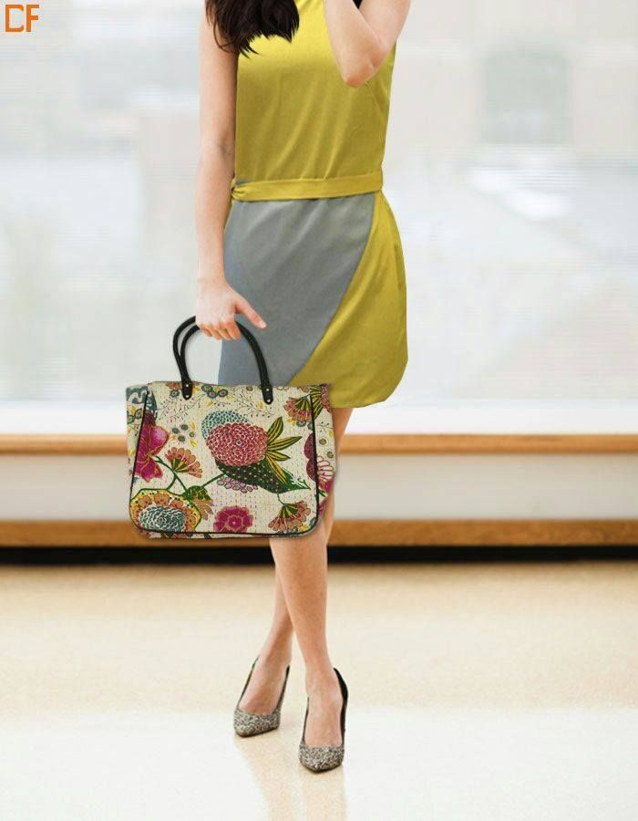 An off white bag with floral print on it makes the heat of summer fade away. #bags #onlinestore #onlineshopping  Visit us on http://www.droomfashion.com/