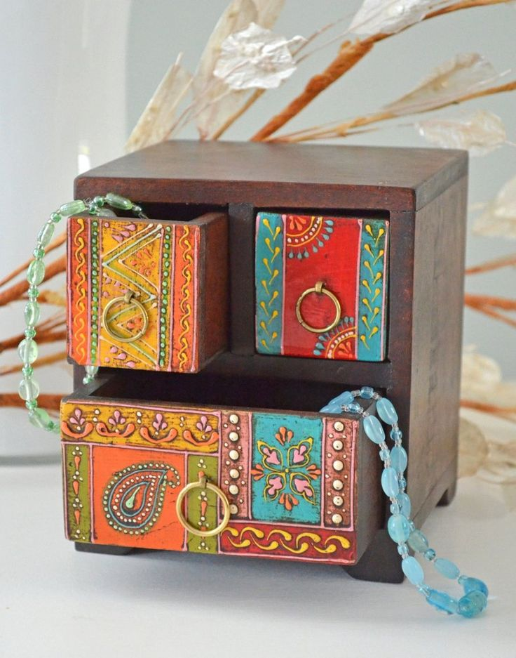 Made from sustainable mango wood this wooden box is hand painted in India. Colorful decorative box, holds jewelry, trinkets, desk items. Unique, fair trade gift.
