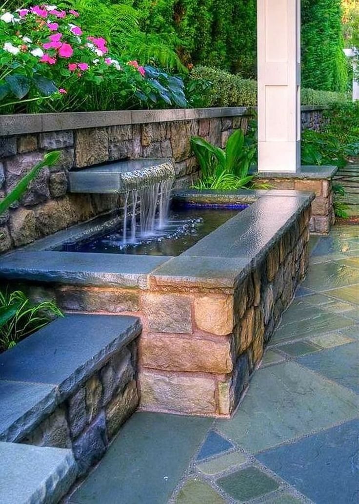 Look at this awesome waterfall idea which will prove best for smaller gardens and patios. A small stone brick pond is built with a small water spill way to create nice waterfall. This is simple yet beautiful and will surely add to the natural characteristics of your garden. You can make small stone tiled benches to sit beside the waterfall.