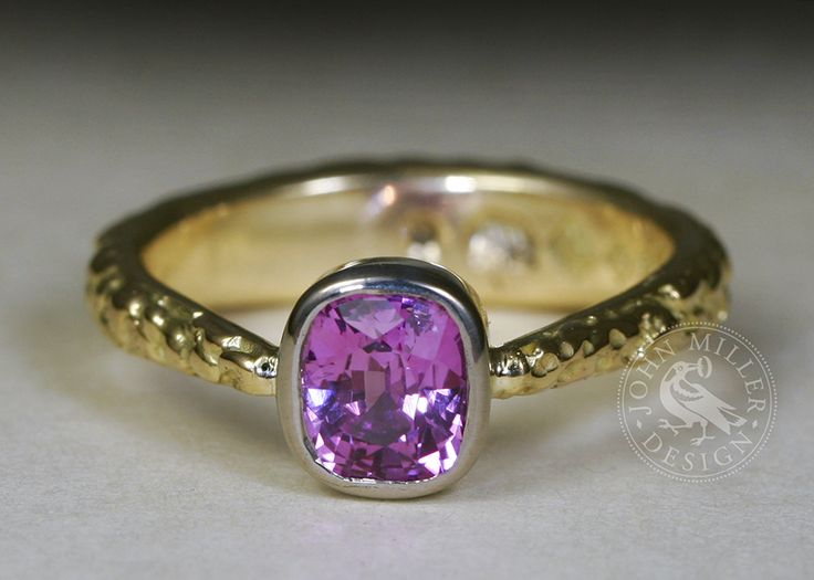 'Fuschia Moon', an 18ct yellow gold fused ring, tapering to a 1.32ct pink sapphire set in an 18ct white gold bezel. Unseen in this photo, there is also a 15pt E.VS Hearts and Arrows diamond set in the back of the band!