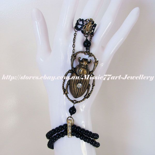 Black and gold Scarab beetle slave bracelet available from Missie77art Jewellery on ebay and etsy