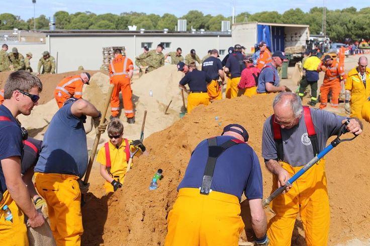 Volunteers filling sand bags