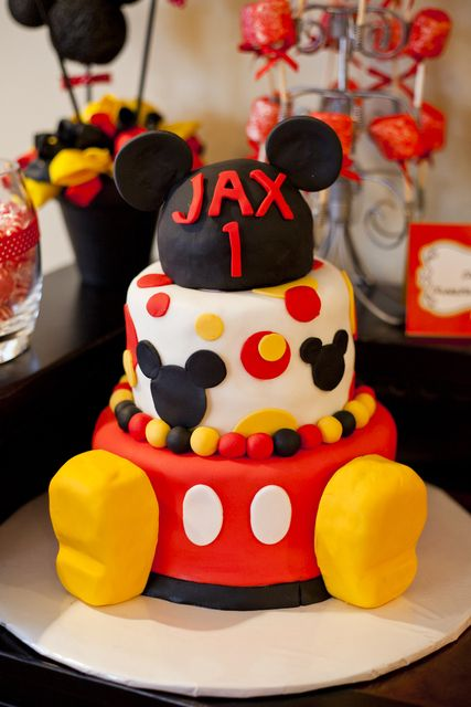 Cute Mickey cake with what I think is fondant covered  rice krispy feet