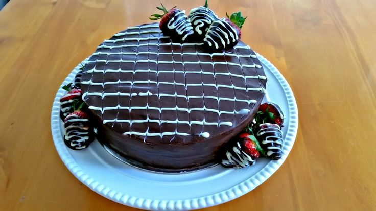Chocolate Cake in chocolate ganache and strawberries