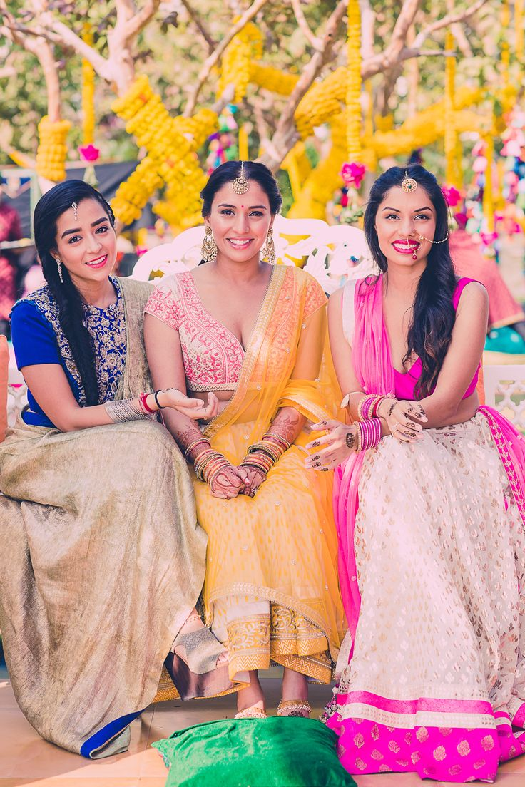 The bride, Tarisha Patel shares a beautiful moment with her besties from her #destinationwedding in Udaipur. She looks breathtaking in a #AnitaDongre #bridal creation. #mehendi #WeddingAlbums