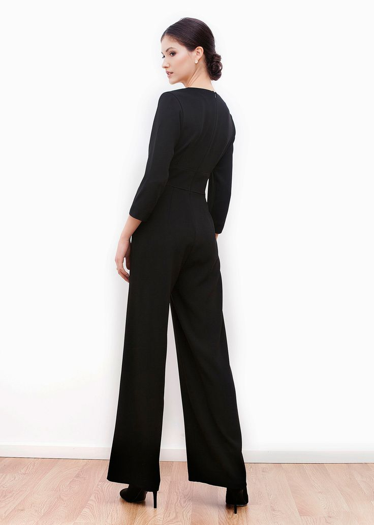 Celine jumpsuit. Enhance your urban wardrobe with this relaxed yet very elegant piece. It features V-neckline, fitted waistband with gentle folds above and wide legs. You will love the perfect balance between modern chic and classic femininity.