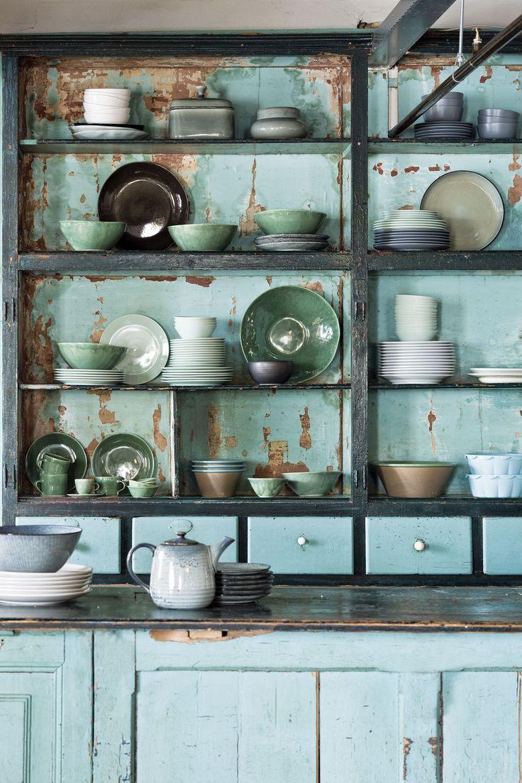 Industrial blue cupboard with pastel and natural colored tableware | Photography Jeroen van der Spek | Styling Cleo Scheulderman | #mijnservies