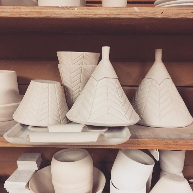 Bisque fire done! I can't believe how many people have asked me what the conical lidded vessels are for... any thoughts? All I got is candles.  #stoneware #pottery #ceramics #clay #handmade #handmadeisbetter #ceramica #ceramic #keramik #shoplocal #vancouver #instapottery #potterystudio #iloveclay via: #probeatzpromo