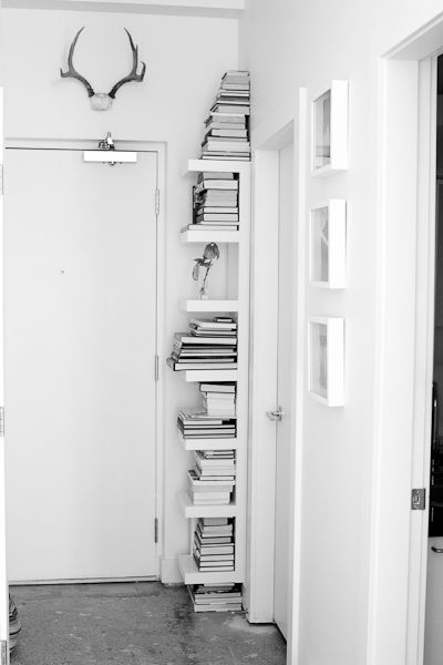 Corner behind the door is usually a wasted space -  good idea for bookshelves.