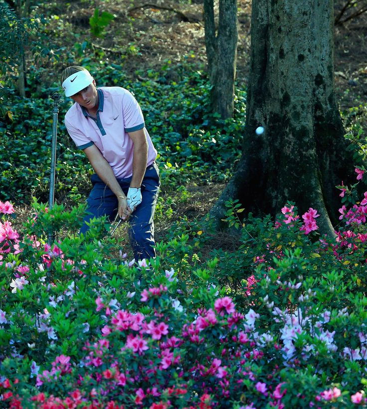 At Amen Corner, Masters Scores Turn for the Worse - NYTimes.com: Russell Henley playing a shot from the flowers at the 13th hole, finished with a 73. 10 April 2014.