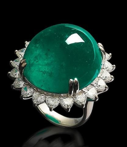 A cabochon emerald and diamond ring