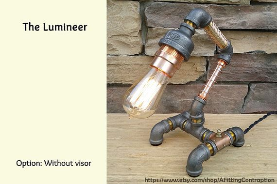 Add a bit of industrial charm to your world. Perfect on a desk, shelf or anywhere, the Lumineer lamp features:  - Constructed from industrial pipe fittings including copper, black steel and brass.  - Switch plate is constructed from hand-hammered copper plate with brass rivets. Please note this is a custom item and variations may occur.  - Includes standard sized 40W, 120V Edison-style light bulb  - Lamp feet are padded in felt to protect your furniture  - An antique style new electrical…