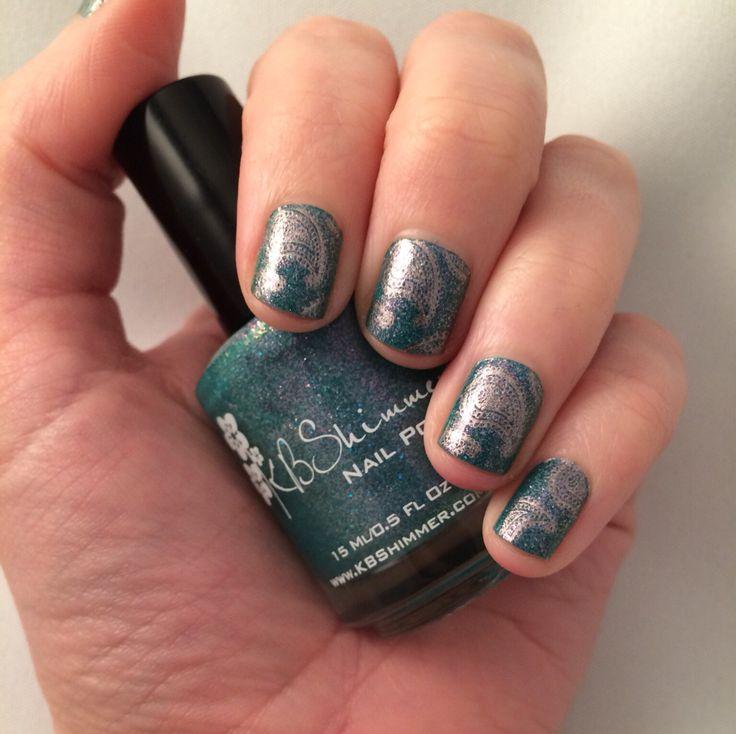 Nail art. Teal nails with paisley stamping.