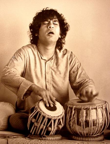 Ustad Zakir Hussain lost in the rhythms of his mesmerizing TABLA beats...!