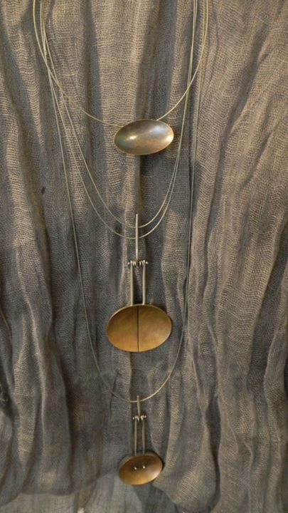 silver and copper necklaces by Talya Baharal.