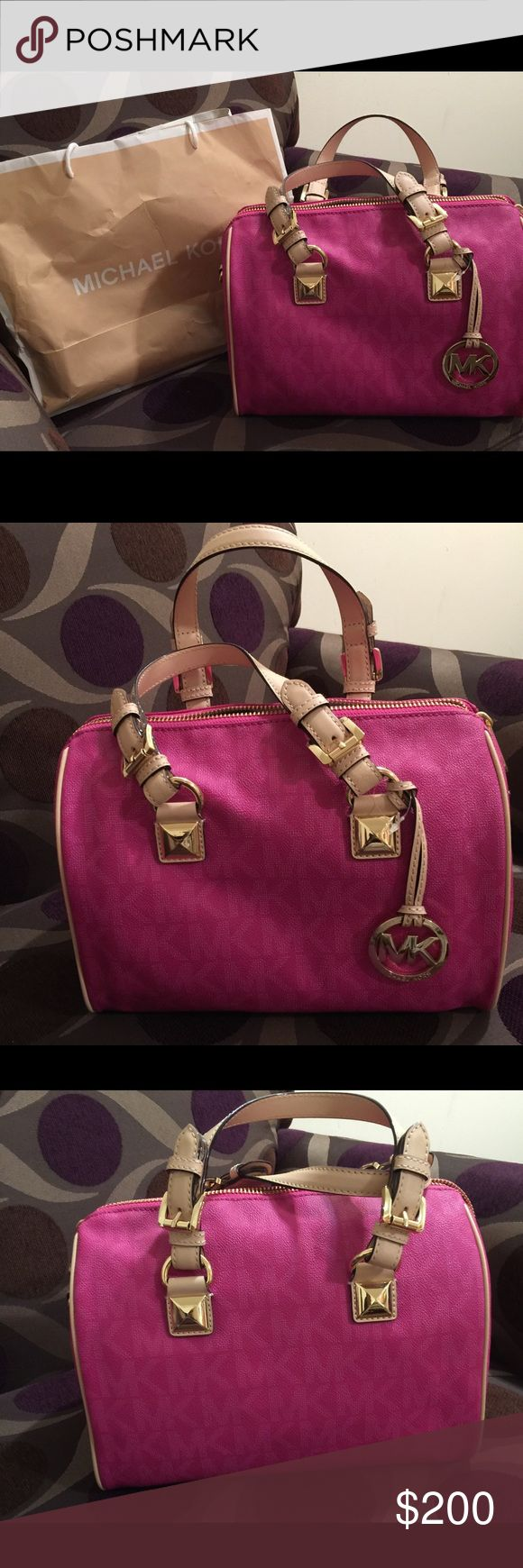 Women satchel tote bag Pink and brown women Michael Kors bag, worn one time and haven't look back at it since. Still in good shape, like new.. no signs of wear and tear. Very spacious on the inside KORS Michael Kors Bags Satchels