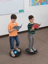 reading balance boards kinesthetic learning desks for classrooms- pedal desks, standing desks, elementary students flexible seating for adhd students and fidgety classrooms - teachers say helps students stay focus and engaged - kidsfit.com