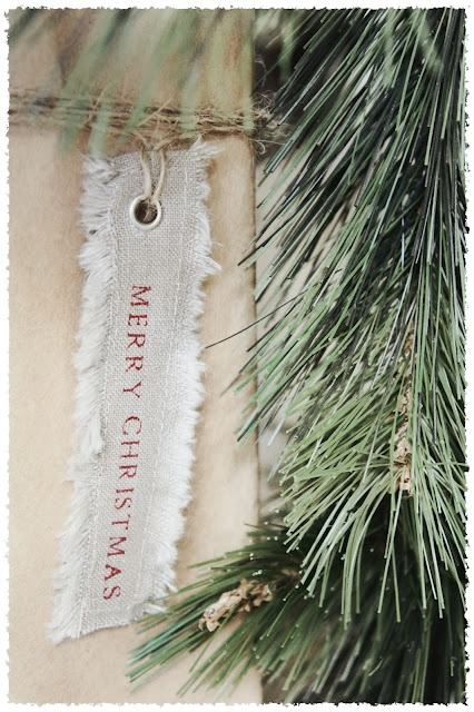Simple to stamp Christmas tag.  Love the frayed edges. I LOVE handstamping on fabric like this.