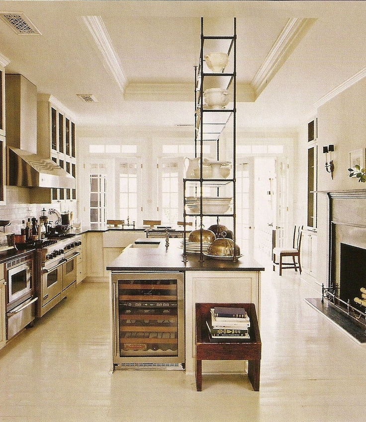 Darryl Carter's DC townhouse kitchen, with the etagere - originally used in the dining area - now placed atop a counter.