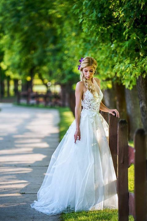 Henrietta wears Nora Sarman Bridal