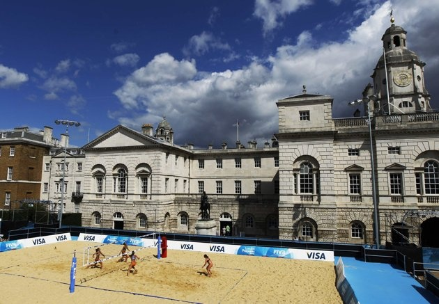 Teams from Spain and the Netherlands take part in a practice session ahead of the FIVB Beach Volleyball test event for the London 2012 Olympic Games at Horse Guards Parade in London August 8, 2011.