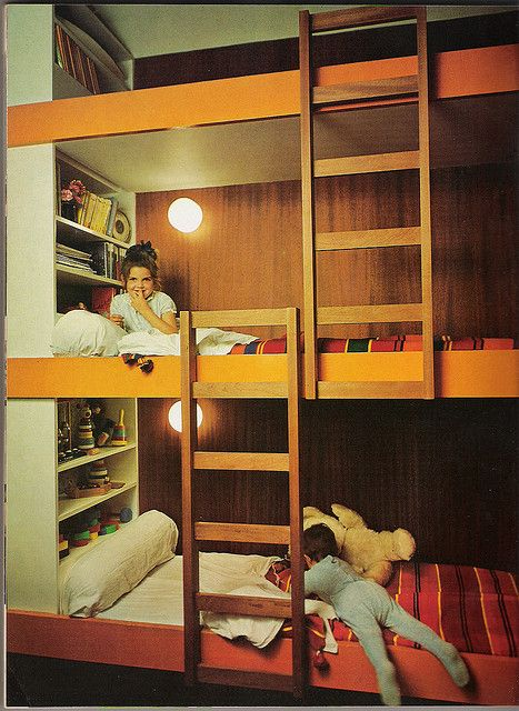 simple triple bunk bed...pic only. Great idea for each child having their own space for personal items, books, etc.  Must be a TALL ceiling!