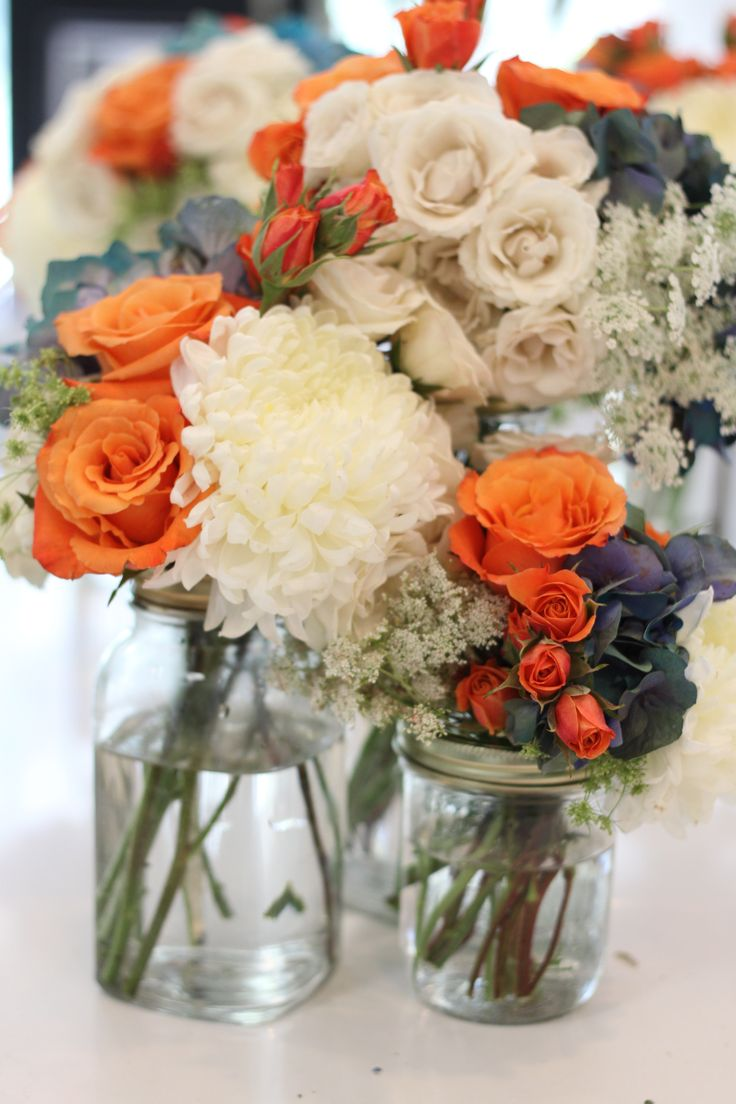 Like the mason jars, different color flowers though, blue glass (antique) in varying shades would be beautiful too