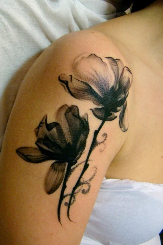 Black and white flower watercolor tattoo